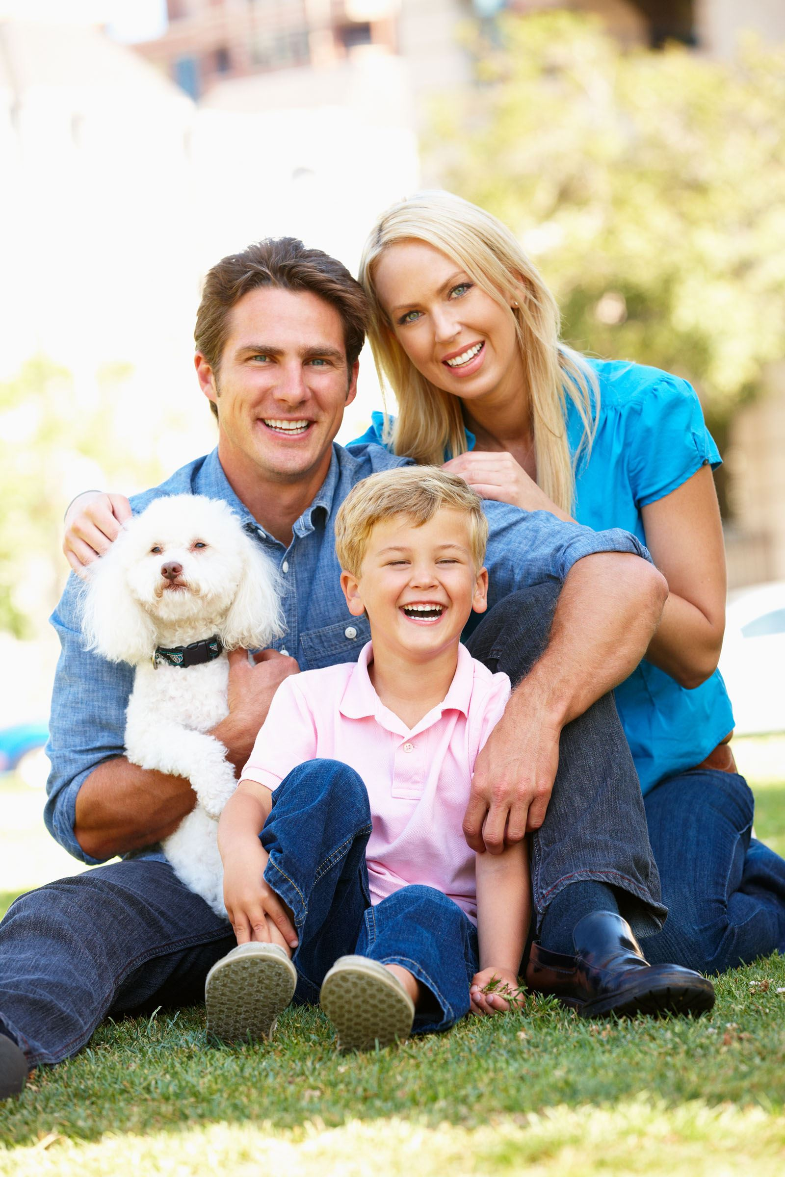 young family with white dog